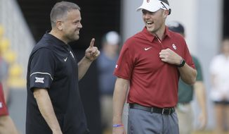 FILE - In this Sept. 23, 2017, file photo, Baylor head coach Matt Rhule, left, and Oklahoma head coach Lincoln Riley talk on the field before an NCAA college football game in Waco, Texas. Baylor plays at Oklahoma on Saturday, Sept. 29, 2018. (AP Photo/LM Otero, File)