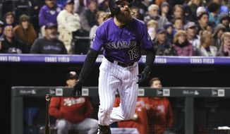 Colorado Rockies' Charlie Blackmon watches his home run during the third inning off Washington Nationals starting pitcher Joe Ross during a baseball game Friday, Sept. 28, 2018, in Denver. (AP Photo/John Leyba)
