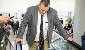 Sen. Jon Tester, D-Mont., listens to a question from a reporter as he arrives at the Capitol for policy luncheons, Tuesday, Sept. 25, 2018, in Washington. (AP Photo/Andrew Harnik)