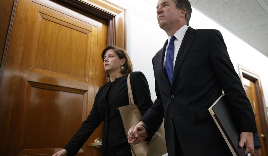 Brett Kavanaugh, President Donald Trump's Supreme Court nominee, and his wife Ashley Kavanaugh, hold hands as they arrive for a Senate Judiciary Committee hearing on Capitol Hill in Washington, Thursday, Sept. 27, 2018. (AP Photo/Carolyn Kaster)