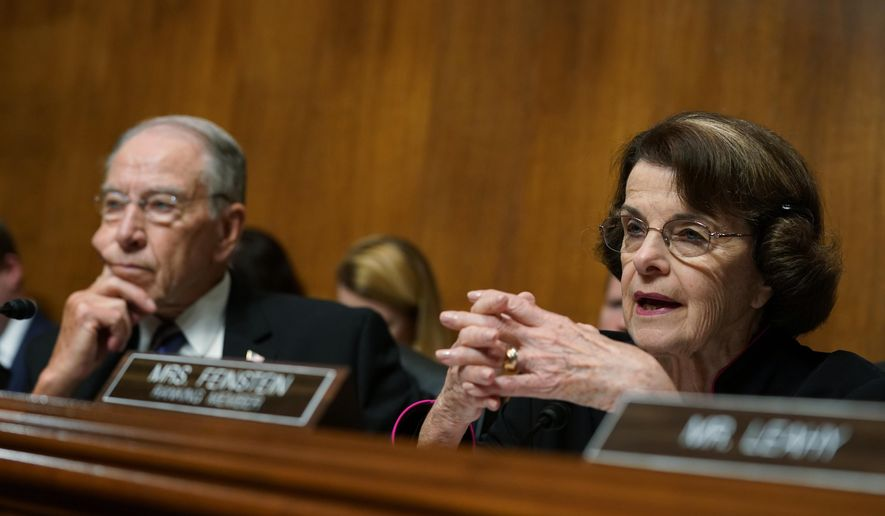 Ranking member Sen. Dianne Feinstein, D-Calif., speaks during a Senate Judiciary Committee hearing and Chairman Chuck Grassley, R-Iowa, left, looks on, as Christine Blasey Ford testifies, Thursday, Sept. 27, 2018 on Capitol Hill in Washington. (AP Photo/Andrew Harnik, Pool) ** FILE **