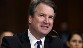 In this Sept. 27, 2018, photo, Supreme Court nominee Brett Kavanaugh testifies before the Senate Judiciary Committee on Capitol Hill in Washington. The Senate Judiciary Committee advanced Kavanaugh's nomination for the Supreme Court after agreeing to a late call from Sen. Jeff Flake, R-Ariz., for a one week investigation into sexual assault allegations against the high court nominee. (AP Photo/Andrew Harnik, Pool)