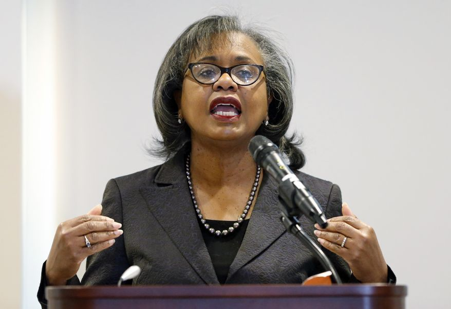 FILE - In this Sept. 26, 2018 file photo, Anita Hill speaks at the University of Utah in Salt Lake City.  Hill says one of the things that stood out to her from Supreme Court nominee Brett Kavanaugh's hearing was how his emotional and angry testimony compared to the calm testimony of the woman accusing him of sexual assault. Hill gave Senate testimony in 1991 about her allegations of sexual harassment by then-Supreme Court nominee Clarence Thomas. Hill spoke on Friday, Sept. 28, in Houston at a gathering of women technologists, one day after Kavanaugh and Christine Blasey Ford testified before the Senate Judiciary Committee. (AP Photo/Rick Bowmer, File)