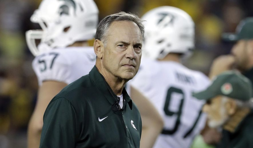 FILE - In this Oct. 7, 2017, file photo, Michigan State head coach Mark Dantonio watches warmups before an NCAA college football game against Michigan in Ann Arbor, Mich. After starting Big Ten play with a win over Indiana, No. 21 Michigan State takes a break from the conference schedule for a matchup with Central Michigan. Dantonio isn't exactly thrilled about it. The Spartans are huge favorites against CMU on Saturday, Sept. 29, 2018, but any game between in-state opponents comes with some intrigue. (AP Photo/Carlos Osorio, File)