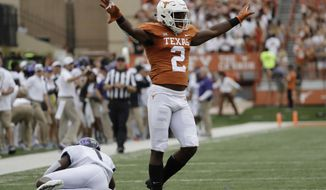Texas defensive back Kris Boyd (2) celebrates after breaking up a pass intended for TCU wide receiver Jalen Reagor, left, during the first half of an NCAA college football game, Saturday, Sept. 22, 2018, in Austin, Texas. (AP Photo/Eric Gay)