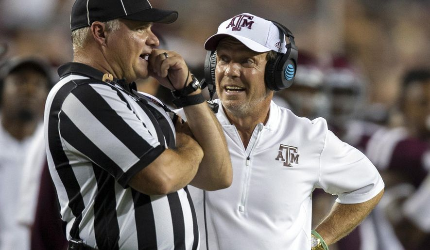 FILE - In this Saturday, Sept. 15, 2018, file photo, Texas A&M head coach Jimbo Fisher argues a call with an official during the second half of an NCAA college football game against Louisiana Monroe in College Station, Texas. The Aggies take on Arkansas on Saturday in the home stadium of the Dallas Cowboys in Arlington, Texas. (AP Photo/Sam Craft, File)