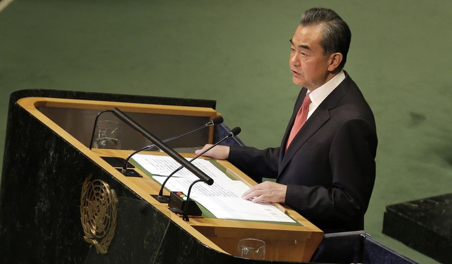 China's Foreign Minister Wang Yi addresses the 73rd session of the United Nations General Assembly, at U.N. headquarters, Friday, Sept. 28, 2018. (AP Photo/Seth Wenig)