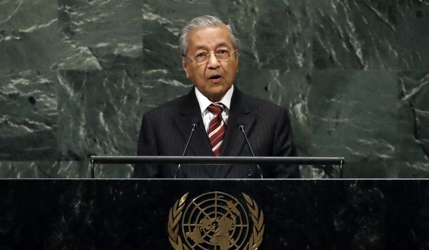 Malaysia's Prime Minister Mahathir Mohamad addresses the 73rd session of the United Nations General Assembly, at U.N. headquarters, Friday, Sept. 28, 2018. (AP Photo/Richard Drew) **FILE**