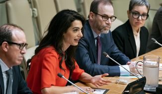 "International human rights lawyer Amal Clooney answers a question during a conference called ""Press Behind Bars: Undermining Justice and Democracy,"" at the 73rd session of the United Nations General Assembly, at U.N. headquarters, Friday, Sept. 28, 2018. Left is Joel Simon, Executive Director of the Committee to Protect Journalists, and right center is Steven J. Adler, President and Editor-in-Chief of Reuters. (AP Photo/Craig Ruttle)"