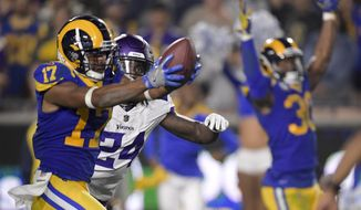 Los Angeles Rams wide receiver Robert Woods celebrates after scoring past Minnesota Vikings defensive back Holton Hill during the second half in an NFL football game Thursday, Sept. 27, 2018, in Los Angeles. (AP Photo/Mark J. Terrill)