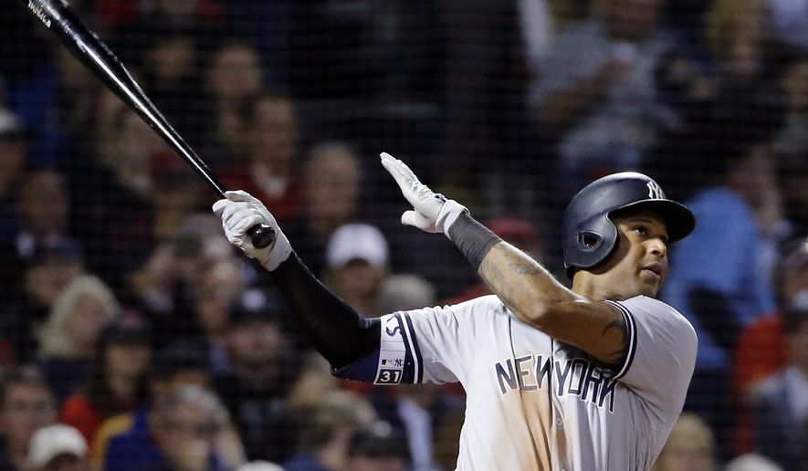 New York Yankees' Aaron Hicks hits a three-run home run against the Boston Red Sox in the fourth inning of a baseball game at Fenway Park, Friday, Sept. 28, 2018, in Boston. (AP Photo/Elise Amendola)