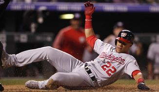 Washington Nationals' Juan Soto scores on a single hit by Wilmer Difo off Colorado Rockies relief pitcher Jake McGee in the seventh inning of a baseball game Saturday, Sept. 29, 2018, in Denver. (AP Photo/David Zalubowski)