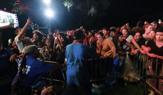 Concert goers surge forward after a barricade got knocked over at the 2018 Global Citizens Festival in Central Park on Saturday, Sept. 29, 2018, in New York. Authorities quickly assured the crowd they were safe after the barrier fell Saturday evening. (Photo by Evan Agostini/Invision/AP)