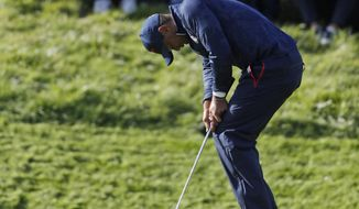 Tiger Woods of the US reacts after missing a putt on the 8th green during a fourball match on the second day of the 42nd Ryder Cup at Le Golf National in Saint-Quentin-en-Yvelines, outside Paris, France, Saturday, Sept. 29, 2018. (AP Photo/Alastair Grant)