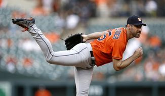 Houston Astros starting pitcher Justin Verlander follows through on a pitch to the Baltimore Orioles in the first inning of the first baseball game of a doubleheader, Saturday, Sept. 29, 2018, in Baltimore. (AP Photo/Patrick Semansky)