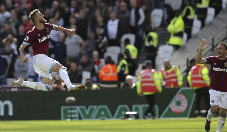 West Ham's Andriy Yarmolenko celebrates after scoring his sides second goal, during the English Premier League soccer match between West Ham United and Manchester United at London Stadium in London in London, England, Saturday, Sept. 29, 2018. (AP Photo/Tim Ireland)