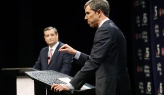 In this Sept. 21, 2018 photo, Republican U.S. Senator Ted Cruz, left, and Democratic U.S. Representative Beto O'Rourke, right, take part in their first debate for the Texas U.S. Senate in Dallas. The second debate between O'Rourke and Cruz has been postponed because the Senate may be in session this weekend to vote on Brett Kavanaugh's confirmation to the Supreme Court. (Tom Fox/The Dallas Morning News via AP, Pool) **FILE**