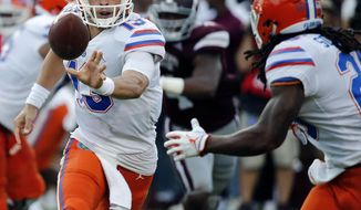 Florida quarterback Feleipe Franks (13) pitches out to running back Jordan Scarlett (25) during the first half of an NCAA college football game against Mississippi State in Starkville, Miss., Saturday, Sept. 29, 2018. (AP Photo/Rogelio V. Solis)