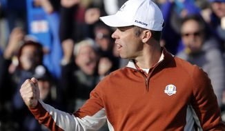 Europe's Paul Casey reacts after making a birdie put during his fourball match on the opening day of the 2018 Ryder Cup at Le Golf National in Saint Quentin-en-Yvelines, outside Paris, France, Saturday, Sept. 29, 2018. (AP Photo/Laurent Cipriani)