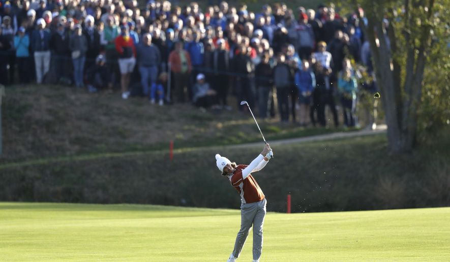 Europe's Tommy Fleetwood plays from the fairway to the 1st green during a fourball match on the second day of the 42nd Ryder Cup at Le Golf National in Saint-Quentin-en-Yvelines, outside Paris, France, Saturday, Sept. 29, 2018. (AP Photo/Alastair Grant)