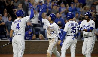 Kansas City Royals' Adalberto Mondesi (27) celebrates with Alex Gordon (4) after hitting a three-run home run during the sixth inning of a baseball game against the Cleveland Indians on Saturday, Sept. 29, 2018, in Kansas City, Mo. (AP Photo/Charlie Riedel)