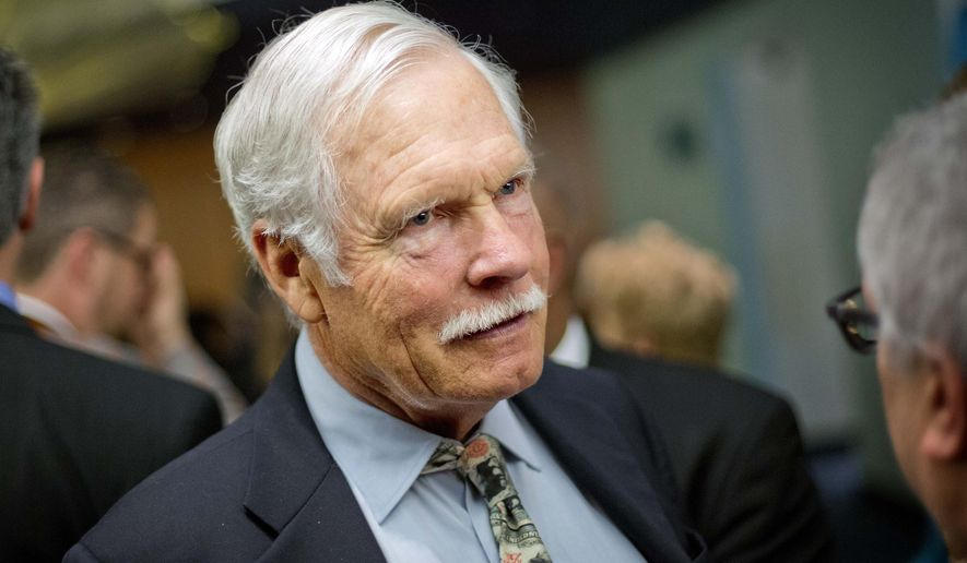 """FILE - In this Dec. 6, 2013, file photo, media mogul Ted Turner talks with guests at the Captain Planet Foundation benefit gala in Atlanta. CNN founder Turner still occasionally watches the network he started nearly four decades ago, although he thinks it's a little heavy on politics.Turner said in an interview with """"CBS Sunday Morning"""" that airs this weekend that he'd prefer his old network had a more balanced agenda, """"but that's just one man's opinion.""""  (AP Photo/David Goldman, File)"""