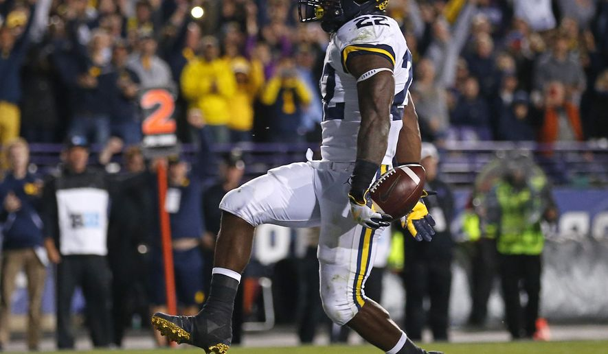 Michigan's Karan Higdon runs in to score a touchdown against Northwestern during the second half of an NCAA college football game Saturday, Sept. 29, 2018, in Evanston, Ill. (AP Photo/Jim Young)