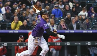 Colorado Rockies' Nolan Arenado watches his double during the second inning against the Washington Nationals in a baseball game Friday, Sept. 28, 2018, in Denver. (AP Photo/John Leyba)