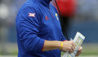 Kansas head coach David Beaty watches during the second half of an NCAA college football game against Oklahoma State in Lawrence, Kan., Saturday, Sept. 29, 2018. (AP Photo/Orlin Wagner)