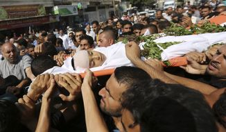 Mourners carry the body of 11 year-old boy, Nasser Musabeh, who was shot and killed by Israeli troops on Friday's ongoing protest at the Gaza Strip's border with Israel, during his funeral in Khan Younis, southern Gaza Strip, Saturday, Sept. 29, 2018. Hundreds have attended the funeral of the boy, apparently the youngest killed by Israeli fire in six months of protests along Gaza's perimeter fence. (AP Photo/Sanad Abu Latifa)