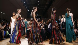 Models wear creations for Elie Saab Spring/Summer 2019 ready-to-wear fashion collection presented in Paris, Saturday, Sept. 29, 2018. (AP Photo/Thibault Camus)