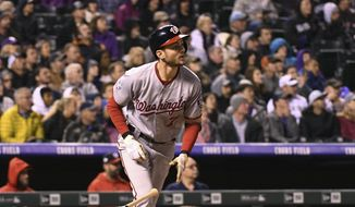 Washington Nationals batter Trea Turner watches his two-run triple to right field during the fourth inning against the Colorado Rockies in a baseball game Friday, Sept. 28, 2018, in Denver. (AP Photo/John Leyba) **FILE**