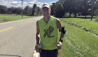 This photo provided by Marybeth Keeler shows John Kennedy running from Utica, Ohio on his way to Johnston. The 52-year-old Type 1 diabetic set out from his northeast Ohio hometown of Aurora on Friday for a two-day, 142-mile run to the Ohio Statehouse in Columbus.  Kennedy, an ultra-marathoner, is using the run and 14 stops along the way to draw attention to the rising costs of insulin and other prescription drugs.    ( Marybeth Keeler via AP)