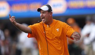 Tennessee head coach Jeremy Pruitt yells to his players during the first half of an NCAA college football game against the Georgia, Saturday, Sept. 29, 2018, in Athens, Ga. (AP Photo/John Bazemore)