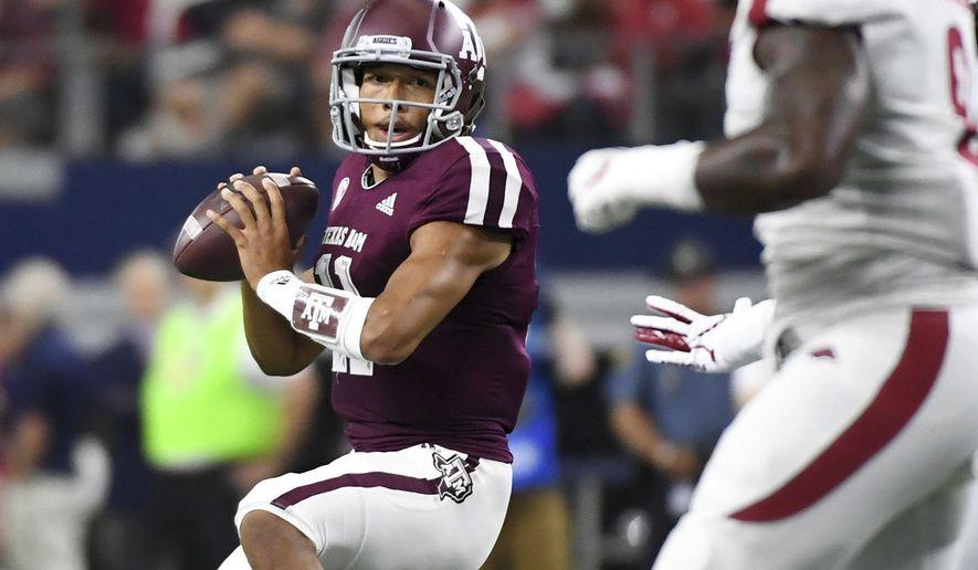 Texas A&M quarterback Kellen Mond (11) looks to pass against Arkansas during the first quarter of an NCAA college football game Saturday, Sept. 29, 2018, in Arlington, Texas. (AP Photo/Jeffrey McWhorter)