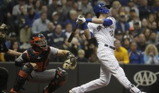 Milwaukee Brewers' Christian Yelich hits a two-run home run during the third inning of a baseball game against the Detroit Tigers Saturday, Sept. 29, 2018, in Milwaukee. (AP Photo/Morry Gash)