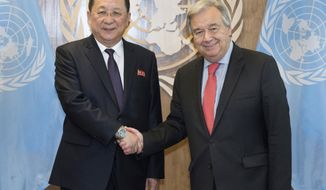 In this photo provided by the United Nations, Ri Yong Ho, left, Minister for Foreign Affairs, Democratic People's Republic of Korea, is greeted by United Nations Secretary General Antonio Guterres during the United Nations General Assembly, Friday, Sept. 28, 2018 at U.N. Headquarters. (Kim Haughton/The United Nations via AP )