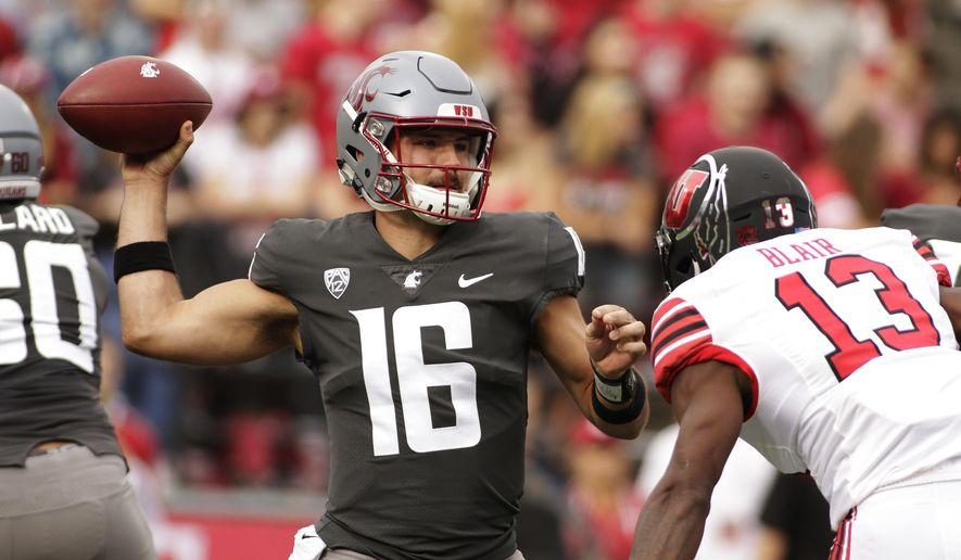 Washington State quarterback Gardner Minshew II (16) throws a pass while under pressure from Utah defensive back Marquise Blair (13) during the first half of an NCAA college football game in Pullman, Wash., Saturday, Sept. 29, 2018. (AP Photo/Young Kwak)