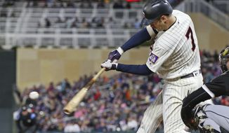 Minnesota Twins' Joe Mauer hits a single off Chicago White Sox pitcher Jeanmar Gomez in the third inning of a baseball game Saturday, Sept. 29, 2018, in Minneapolis. (AP Photo/Jim Mone)