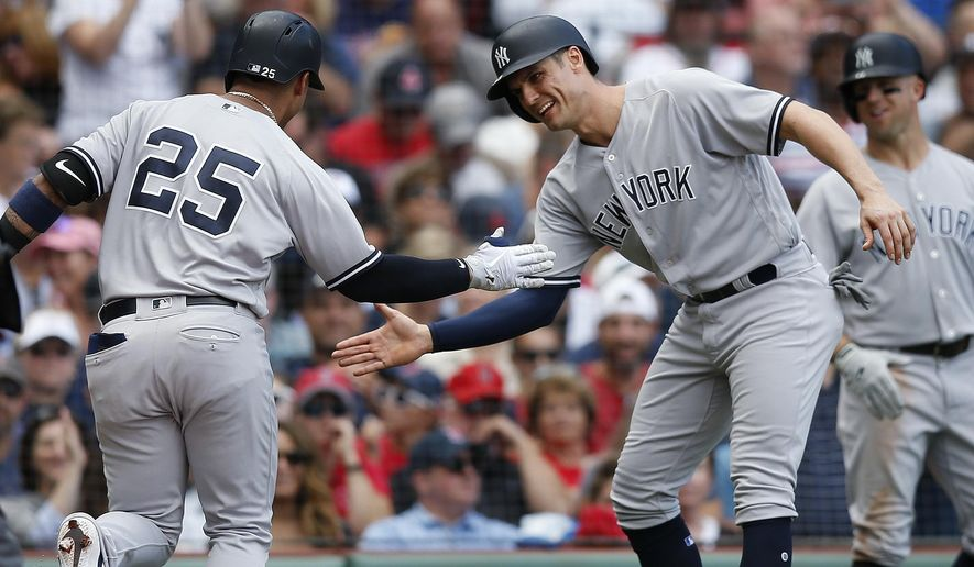 New York Yankees' Gleyber Torres (25) celebrates his two-run home run that also drove in Greg Bird, right, during the fourth inning of a baseball game against the Boston Red Sox in Boston, Saturday, Sept. 29, 2018. (AP Photo/Michael Dwyer)