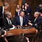 A crowded cast: Sens. Jeff Flake, Lindsey Graham and Mike Crapo have a dialogue following a Senate Judiciary Committee meeting Friday. (Associated Press)