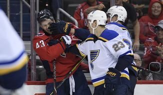 Washington Capitals right wing Tom Wilson (43) battles with St. Louis Blues right wing Dmitrij Jaskin (23) and defenseman Niko Mikkola, right, during the second period of an NHL preseason hockey game, Sunday, Sept. 30, 2018, in Washington. (AP Photo/Nick Wass) ** FILE **