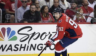 Washington Capitals center Evgeny Kuznetsov (92), of Russia, skates with the puck during the second period of an NHL preseason hockey game against the St. Louis Blues, Sunday, Sept. 30, 2018, in Washington. (AP Photo/Nick Wass) ** FILE **