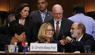 Christine Blasey Ford and her attorneys Debra Katz, foreground left, and Michael Bromwich, foreground right, take a break during testimony before the Senate Judiciary Committee, Thursday, Sept. 27, 2018 in Washington. (Win McNamee/Pool Photo via AP)