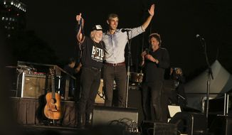 "From left, artist Willie Nelson and Rep. Beto O'Rourke (D-TX) wave to the crowd during the ""Turn Out for Texas"" concert and rally at Auditorium Shores on Saturday, Sept. 29, 2018 in Austin, Texas. O'Rourke is running against Sen. Ted Cruz (R-TX) for his senate seat. (Photo by Laura Roberts/Invision/AP Images)"