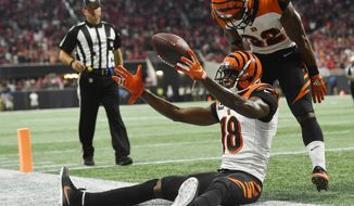 Cincinnati Bengals wide receiver A.J. Green (18) celebrates his game-winning catch against the Atlanta Falcons during the second half of an NFL football game, Sunday, Sept. 30, 2018, in Atlanta. The Cincinnati Bengals won 37-36. (AP Photo/John Amis)