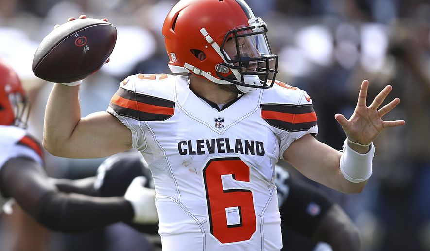 Cleveland Browns quarterback Baker Mayfield (6) passes against the Oakland Raiders during the first half of an NFL football game in Oakland, Calif., Sunday, Sept. 30, 2018. (AP Photo/Ben Margot)