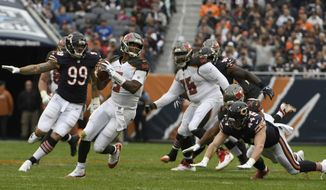 Tampa Bay Buccaneers quarterback Jameis Winston (3) scrambles during the second half of an NFL football game against the Chicago Bears Sunday, Sept. 30, 2018, in Chicago. (AP Photo/David Banks)