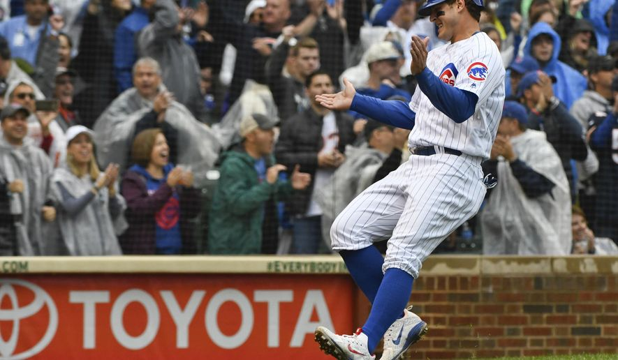 Chicago Cubs' Anthony Rizzo (44) claps after he scored during the third inning of a baseball game against the St. Louis Cardinals on Sunday, Sept. 30, 2018, in Chicago. (AP Photo/Matt Marton)
