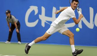 Bernard Tomic of Australia hits a return shot against Joao Sousa of Portugal during their semifinal match in the ATP 250 Chengdu Open tennis tournament in Chengdu in southwestern China's Sichuan province, Saturday, Sept. 29, 2018. Tomic beat Sousa, 2-0. (Chinatopix via AP)